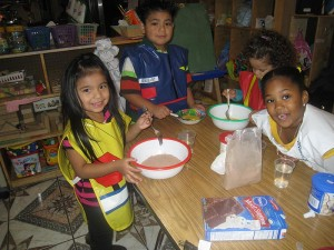Children mixing cupcakes